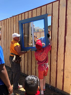 UpLift Colorado volunteers upgrade a house in Mexico with new windows.